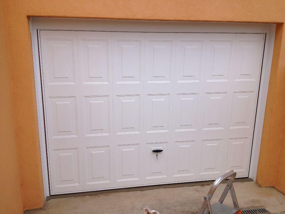 Portes de garages basculantes visioferm 68 haut rhin for Porte de garage basculante sur mesure avec portillon